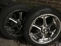 22 Rims And Tires.. they were on a 2004 Chevy Avalanche