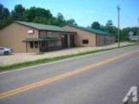12000ft - Retail building with paved lot directly off RT 7