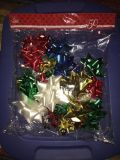 BAG OF 50 PEEL N STICK BOWS. 3 BAGS AVAILABLE. ALL NEW NEVER OPENED