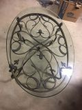 Beveled glass coffee table with iron base