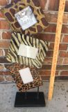 Tall animal print frames - bottom one does not have glass