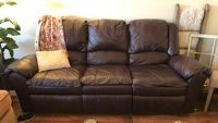 leather couch 2 TVs