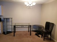 Glass Table with chairs and matching entertainment centers