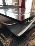 Wooden coffee table with glass center