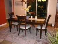 Dining Table with 4 chairs with white padded seats.