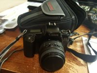 Canon EOS 1000F DSLR camera with case and battery