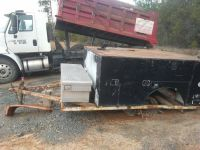 Enclosed utility bed on trailer