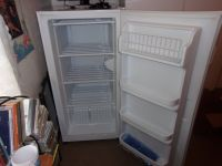 Small upright freezer excellant condition and runs perfect. No scraches or dents.