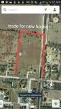 9 acres. ..Trade .... for 3-5 bedroom house (1825 west Rogers)