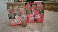 2 six pack coke bottles