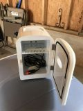 Small electric cooler w/vehicle electric plug in