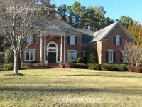 This lovely 5 Bed/5.2 Bath custom home located in prestigious Sedgefield, boasts of a two-story Great Room with French doors leading to an outdoor living space that includes a large brick patio, built-in range, and a large fenced, well-manicured backyard