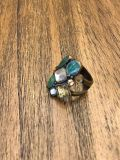 Beautiful ring with multi colored gems to match a variety of things! Excellent condtion