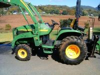 $2,500, Compact tractor with loader and backhoe