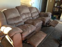 Reclining sofa and loveseat by Ashley