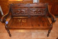 beautifully carved wood bench
