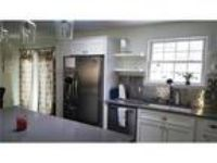 Come enjoy this wonderful furnished 3 BR rental. Parking Available!