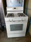 Whirlpool Refrigerator with Ice maker 21 Cu Ft. + Kenmore stove With manuals beige color