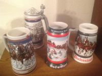 2 Budweiser and 1 Avon Steins
