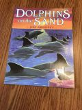 Paperback. Dolphins on the sand. Very good condition