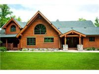 Awesome, authentic log cabin home on Swan Lake, featured in Lake & Home Magazine!