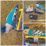 Little Live Pets Clever Keet Bird with two ride on teeter totter wagons, in GUC, includes batteries, works great, $7.00