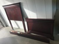 Cherry wood twin bed frame, all parts are included, headboard, footboard, rails, screws. New from Haverty s paid $500. Selling for $100