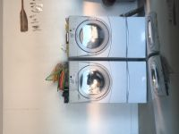Washer and dryer: front loader . Dryer panel has slight button glitch