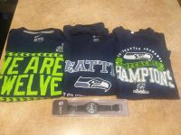 Seahawks lot. 3 large shirts and brand new Hawks watch