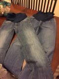 Two pairs of maternity jeans with the band waist. Brand is motherhood maternity
