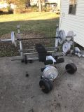 Benchpress squat rack and 550 pounds of weight