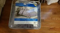Comforter set. Queen size. Never taken out of bag