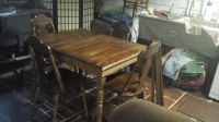 very old kitchen table and 4 chairs
