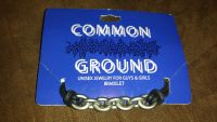 New common grounds black and silver unisex bracelet