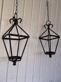 Two (2) Rustic antique wrought iron triangular real candle light lanterns.