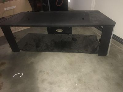 Free tv stand with glass shelfs need gone asap no holds. Fits a 56 inch tv no time to measure