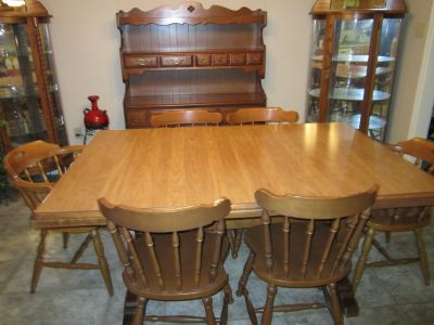 Dining table with 6 chairs and hutch good condition.Solid wood. Table expands W/3 leaves. Price ...
