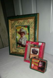 A Christmas Story 10 by 12 frame wh 5 by 7 matted picture, Christmas Story (Ralphie) and TV ornament. All for $6.