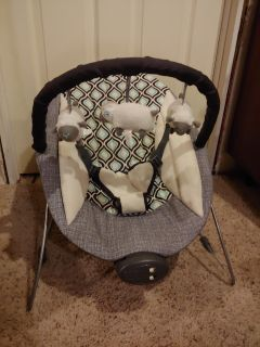 Portable baby bouncer seat with sound and vibration