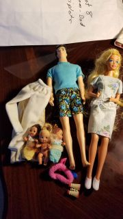 Mom, dad, and triplet baby barbies