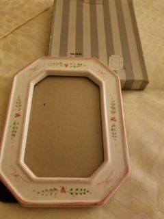 Heavy ceramic frame adorned with hearts
