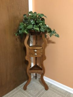 Cuevas oak wood decorative plant stand with drawers