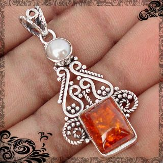 New - Authentic Baltic Amber and Pearl 925 Sterling Silver Pendant (Includes a chain)