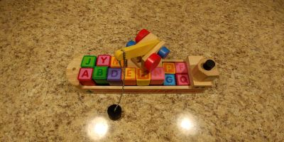 Wooden boat and letter blocks