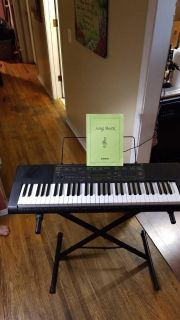Casio CTK-2080 keyboard with songbook