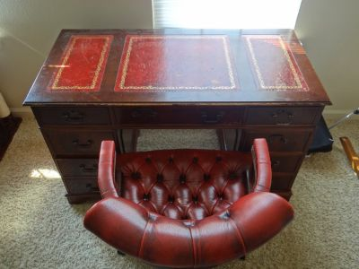 Red-leather desk and Captain's chair
