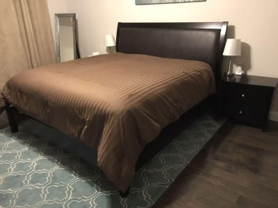 King sized bed and 2 matching bedside tables