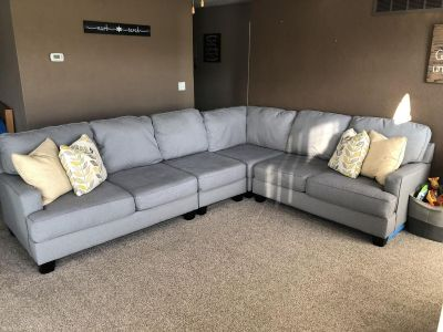 Grey sectional with 4 decorative pillows
