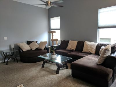 Microfiber Sectional w/ chaise, matching round swivel chair, coffee and end table