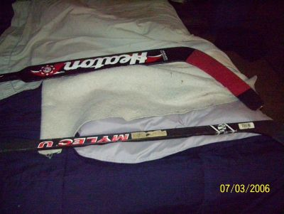 this is a player stick and a goalie stick